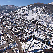 SHOT 3/2/17 11:30:58 AM - Aerial photos of Park City, Utah. Park City lies east of Salt Lake City in the western state of Utah. Framed by the craggy Wasatch Range, it's bordered by the Deer Valley Resort and the huge Park City Mountain Resort, both known for their ski slopes. Utah Olympic Park, to the north, hosted the 2002 Winter Olympics and is now predominantly a training facility. In town, Main Street is lined with buildings built primarily during a 19th-century silver mining boom that have become numerous restaurants, bars and shops. (Photo by Marc Piscotty / © 2017)