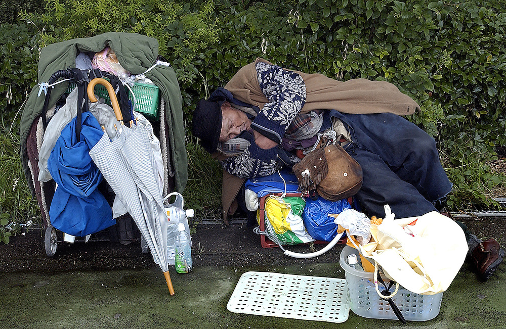 One of many of Tokyo's homeless sleeps outdoors June 2002..©David Dare Parker/AsiaWorks Photography