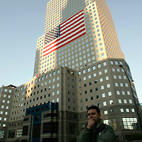 Troy Krastev weeps at the site of the World Trade Center attack as a shadow of a nearby building is cast on part of the World Financial Center on the fourth anniversary of the attack in New York September 11, 2005. Krastev's friend lost a brother in the disaster.