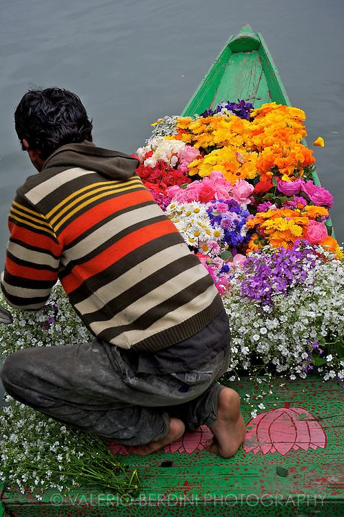 A flower seller on Dal Lake Srinagar. Kashmir. India