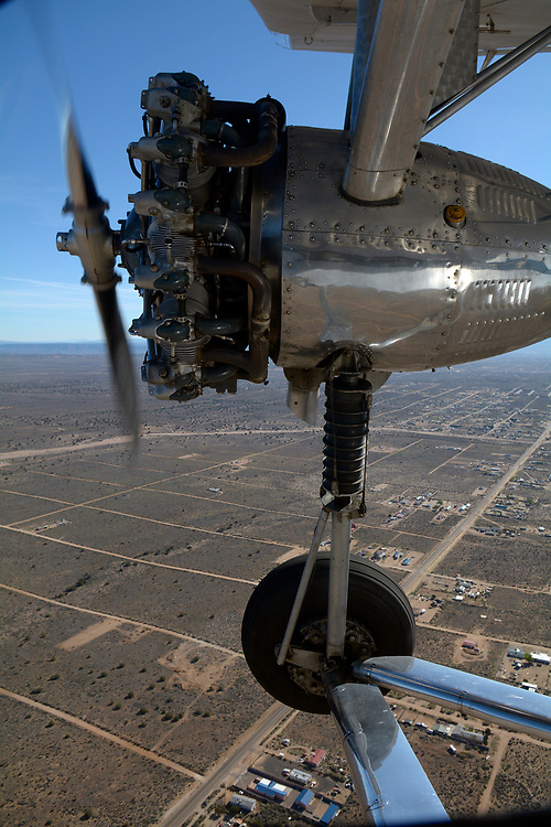 gbs040617i/RIO-WEST -- One of  three radial engines on a 1928 Ford Tri-Motor is sandwiched between the wing and landing gear while on a flight over the West mesa on Thursday, April 6, 2017. (Greg Sorber/Albuquerque Journal)