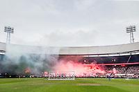 ROTTERDAM - Eerste training van Feyenoord , voetbal , seizoen 2015-2016 , Stadion De Kuip , 28-06-2015 ,Sfeerbeeld overzicht van de spelers op het veld met het massale vuurwerk op de achtergrond