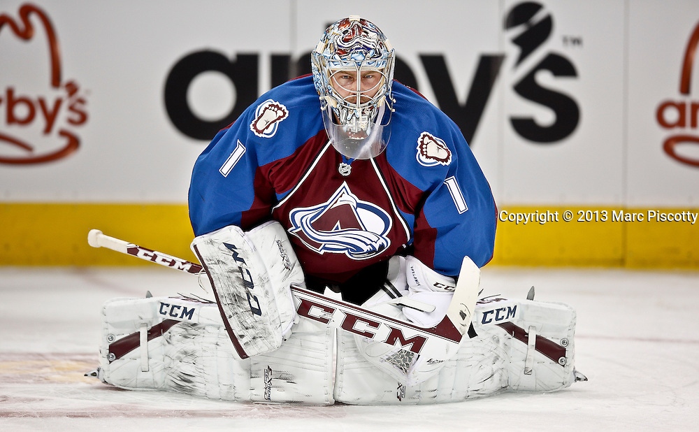 SHOT 11/19/13 7:39:38 PM - Goaltender Semyon Varlamov #1of the Colorado Avalanche stretches during pre-game warmups before playing against the Chicago Blackhawks during their regular season NHL game at the Pepsi Center in Denver, Co. on Tuesday November 19, 2013. The Avalanche won the game 5-1. Varlamov could face charges after being accused of kidnapping and domestic abuse by his girlfriend. (Photo by Marc Piscotty / © 2013)