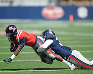 Mark Dodson (7) is tackled by Mike Marry (38) at Ole Miss' Grove Bowl at Vaught-Hemingway Stadium in Oxford, Miss. on Saturday, April 13, 2013.