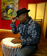 Robbe Hardnette is a co-owner of Bamboo Lifestyles, a shop for all things bamboo on Hawthorne. he relaxes in the showroom playing an African drum...