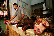 The meat markets on the Tala Kebira in the ancient Medina of Fes, Morocco are a great place to see some unusual and unique spectacles like these goat heads on Sunday afternoon, June 10, 2007. You can also find brain, livers, camel heads and other meats from various specialized butchers, each having their own specialty meat.
