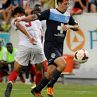 Wilmington's Cody Arnoux moves the ball past Arizona's Jonathan Top Friday July 25, 2014 at Legion Stadium in Wilmington, N.C. (Jason A. Frizzelle)