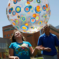 Jessie Matz, 11 participates in group exercise in the 10-week Shapedown Program with volunteer Bill LaJoie (R) at The Children's Hospital in Aurora, Colorado May 29, 2010.  The program is part of the child and teen weight management program at the hospital. REUTERS/Rick Wilking (UNITED STATES)