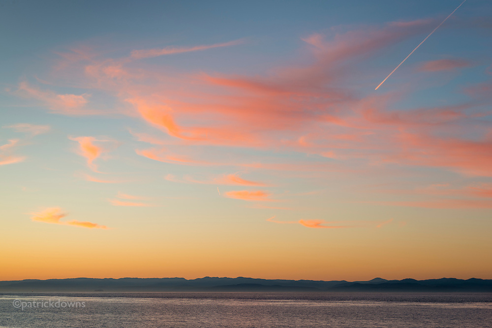 Twilight over Vancouver Island BC, across the Strait of Juan de Fuca as seen from Ediz Hook. Gimme a ticket for an airplane... ain' t got time for a fast train.