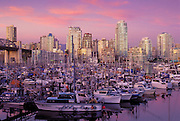 City skyline at sunset from False Creek Marina, Vancouver, British Columbia, Canada.
