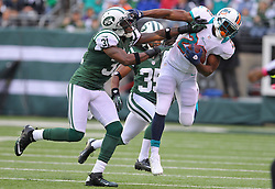 Oct 28, 2012; East Rutherford, NJ, USA; New York Jets cornerback Antonio Cromartie (31) tackles Miami Dolphins running back Reggie Bush (22) during the first half at MetLIfe Stadium.