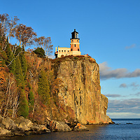 Split Rock Lighthouse in Two Harbors, Minnesota<br /> One of the most recognized and photographed locations in Minnesota is the Split Rock Lighthouse. It was built along the coast of Lake Superior in 1910. Since it was decommissioned in 1969 it has become part of a 7.6 acre park. This State and National Historic Landmark stands on top of a dramatic, 130 foot cliff.  It is always beautiful but especially in the autumn at sunset.