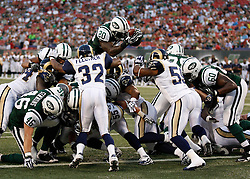 Aug 14, 2009; East Rutherford, NJ, USA;   New York Jets running back Thomas Jones (20) takes a snap from New York Jets quarterback Mark Sanchez (6) in for a one yard touchdown run during the first half at Giants Stadium.