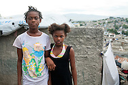 Girls pose for a portrait on a rooftop on July 13, 2010 in the Fort National neighborhood in Port-au-Prince, Haiti.