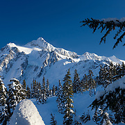 Mount Shuksan, located in the North Cascades of Washington state, is covered in fresh snow on a cold winter day.