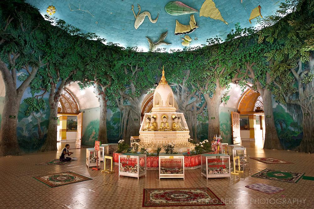A woman prays inside Kaba Aye Paya. A rare hollow pagoda in Rangoon.