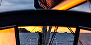 Sunrise. Early winter morning exploration of Otata Island. As viewed from behind my yachts dodger. Hauraki Gulf, Auckland, New Zealand.