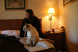 Hurricane Katrina survivor Emma Lou and her cat Baby Girl living in a motel in Columbia, SC [NY Times]