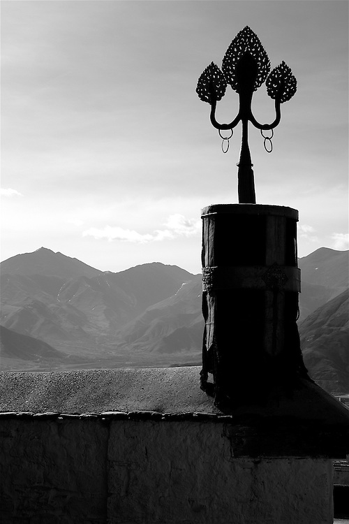 This is the top of a large monastery in downtown Lhasa, Tibet in black and white