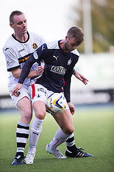 Dumbarton's Andy Graham and Falkirk's Rory Loy.<br /> half time : Falkirk 1v 0 Dumbarton, Scottish Championship game played 20/9/2014 at The Falkirk Stadium .