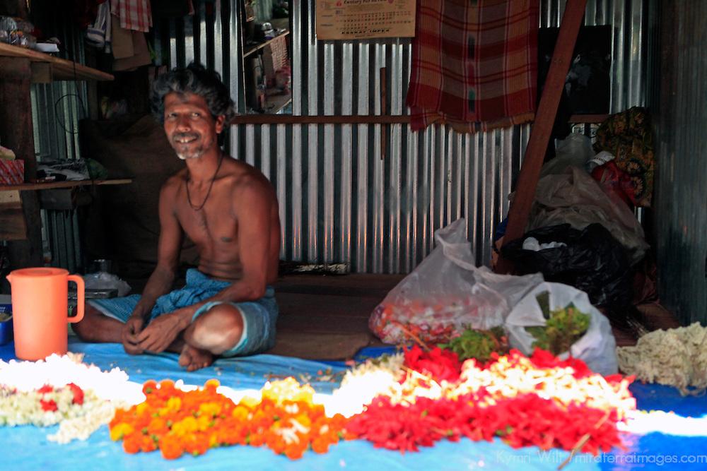 Asia, India, Calcutta. Happy flower vendor in the flower market in Calcutta.