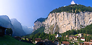 """Staubbach Falls (Staubbachfall) is the highest waterfall in Switzerland, plunging 1000 feet (300 meters) into Lauterbrunnen Valley in the Berner Oberland, the Alps, Europe. The Bernese Highlands are the upper part of Bern Canton. UNESCO lists """"Swiss Alps Jungfrau-Aletsch"""" as a World Heritage Area (2001, 2007). Panorama stitched from three images. Published in """"Light Travel: Photography on the Go"""" book by Tom Dempsey 2009, 2010."""