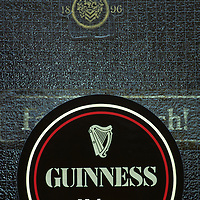 Ireland, Guinness Stout sign on pub door in County Galway on autumn evening