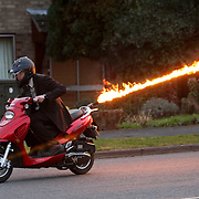 """COLIN FURZE ON HIS FLAME THROWING MOPED... A plumber who adapted his scooter to fire 15ft flames from the rear has been given a police caution following his arrest for an alleged firearms offence....Colin Furze, 30, spent a month modifying his moped with an anti-tailgating flame thrower operated by the flick of a switch...He displayed his James Bond-style scooter, which can travel up to 60mph in the worldwide press two months ago...But Lincolnshire Police spotted the pictures of Mr Furze allegedly riding his scooter on a public highway and arrested him...He was held on suspicion of possessing an object converted into a firearm, and was released on unconditional police bail without charge...When Mr Furze, of Stamford, Lincs, returned to answer bail yesterday (Thurs) he was given a police caution...""""I'm relieved it's all over,"""" he said today (Fri)...SEE COPY CATCHLINE Flame thrower man cautioned"""