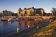 Inner Harbour promenade and the Empress Hotel; Victoria, Vancouver Island, British Columbia, Canada.