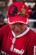 Baseball cap with the image of Che Guevara and Hugo Chávez during the funeral of the President of Venezuela, Caracas, 8th March 2013. During Hugo Chávez funeral many people and stand sold miscellaneous articles that perpetuate Chávez presence. Everything from T-shirts, badges, earrings, baseball caps, sun glasses seemed suitable to have the President's image. The cult of Chávez is now more alive than ever.