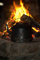 Coffee Warming By a Wood Fire. Image taken with a Nikon D2xs and 85 mm f/1.4 lens (ISO 200, 85 mm, f/1.4, 1/60 sec).