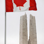 The Canadian flag flying at the ‪Canadian National Vimy Memorial‬ dedicated to the memory of Canadian Expeditionary Force members killed in World War one. The monument is situated at a 100 hectare preserved battlefield with wartime tunnels, trenches, craters and unexploded munitions. The memorial designed by Walter Seymour Allward opened in 1936.