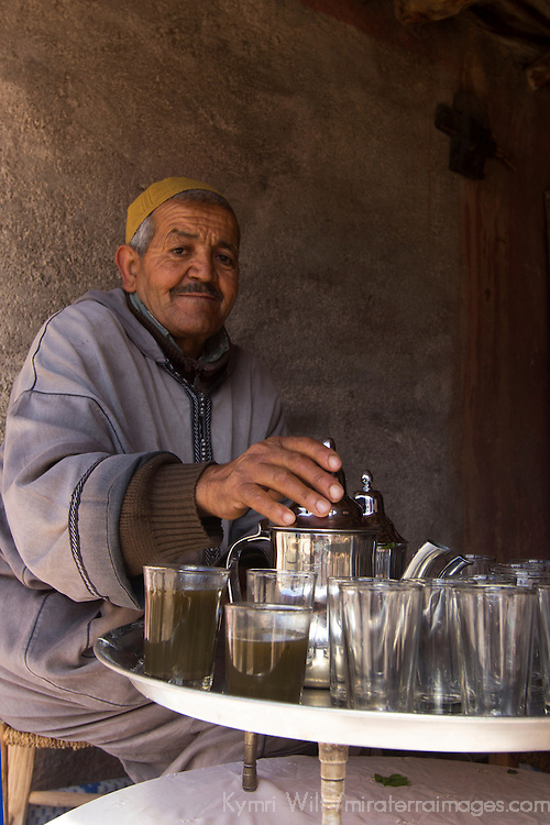 Africa, Morocco, Imlil. Moroccan Berber Villager serving Mint Tea.