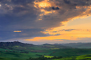 The sky started to clear off right at sunrise, after a night of mighty thunderstorms. Taken in the hills nearby Pienza in Tuscany, Italy, on a morning at the beginning of May.