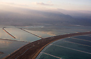 An aerial photo showing evaporation ponds on both the Israeli and Jordanian sides of the Dead Sea  shortly after dawn seen from above in Israel along the southern basin of the Dead Sea ..The World Bank has just  approved a pilot plan for a canal linking the Red Sea to the rapidly shriinking Dead Sea. Israel public radio said the bank will provide 1.25 billion dollars to finance the project. The initial proposal is for a 180 Kilomter (110 miles) channel to transport 200 cubic meters of water, of which half would gush into the Dead Sea and half would feed a giant desalination plant jointly run by Israel, Jordan and the Palestinian Authority. The next stage would see the construction of the canal to supply two billion m3 of water a year to maintain and incress water levels in the Dead Sea, which is on course to dry out by 2050 if nothing is done..(Photo by Heidi Levine/Sipa Press)....