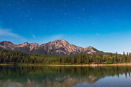 An Iridium satellite flare over Pyramid Mountain and Patricia Lake in Jasper National Park, Sept 4, 2014. This is a stack of 4 frames, each 20 seconds at f/2.8 with the 14mm Rokinon lens and Canon 60Da at ISO 1600, taken as part of a 400-frame time-lapse sequence. The gaps are from the 1 second interval between frames.