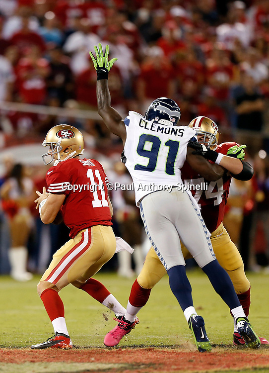 Seattle Seahawks defensive end Chris Clemons (91) stretches out his arm while trying to sack San Francisco 49ers quarterback Alex Smith (11) despite a block by 49ers tackle Joe Staley (74) during the NFL week 7 football game on Thursday, Oct. 18, 2012 in San Francisco. The 49ers won the game 13-6. ©Paul Anthony Spinelli