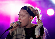 READING, ENGLAND - AUGUST 25:  Grimes performs live on the Dance Stage on Day Two during the Reading Festival 2012 at Richfield Avenue on August 25, 2012 in Reading, England.  (Photo by Simone Joyner/Getty Images)