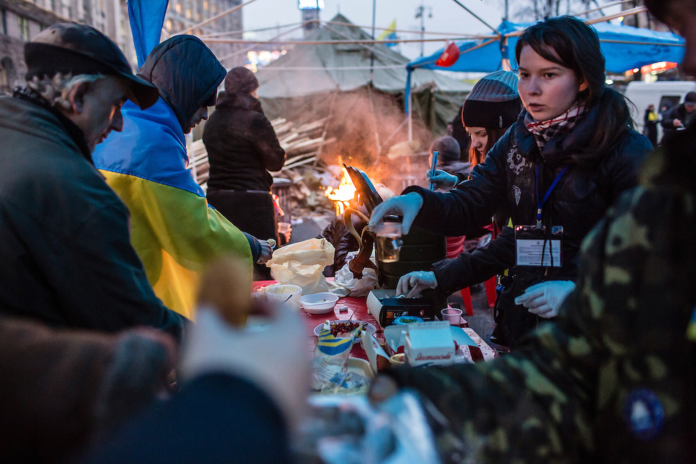 KIEV, UKRAINE - DECEMBER 13: Anti-government protesters distribute food and hot tea under tents set up in the middle of a street leading to Independence Square, which they have occupied for more than three weeks, on December 13, 2013 in Kiev, Ukraine. Thousands of people have been protesting against the government since a decision by Ukrainian president Viktor Yanukovych to suspend a trade and partnership agreement with the European Union in favor of incentives from Russia. (Photo by Brendan Hoffman/Getty Images) *** Local Caption ***