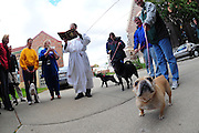 Fr. John Girotti, pastor of St. John the Evangelist Parish in Green Bay, recites a prayer before a blessing of pets held after Mass Oct. 2. The pet blessing was held in observance of the feast of St. Francis of Assisi Oct. 4. (Sam Lucero photo)