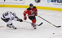 June 2; Newark, NJ, USA; New Jersey Devils defenseman Marek Zidlicky (2) skates with the puck while being defended by Los Angeles Kings center Jarret Stoll (28) during the first period of the 2012 Stanley Cup Finals Game 2 at the Prudential Center.