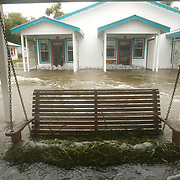 Seaweed clings to the swing at the Faraway Inn as the surge from Tropical Storm Alberto makes in way on shore in Cedar Key, Florida June13, 2006. REUTERS/Scott Audette (UNITED STATES)