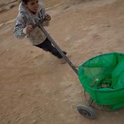 Bedouin kid clean his village. Photo by Oren Nahshon