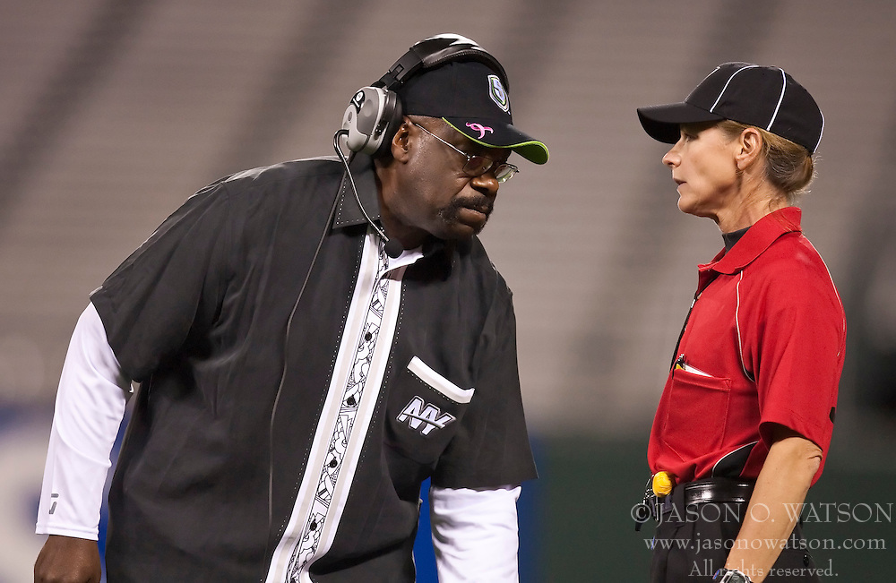 October 17, 2009; San Francisco, CA, USA;  New York Sentinels head coach Ted Cottrell talks to head linesman Terri Valenti during the first quarter against the California Redwoods at AT&T Park.  California won 24-7.