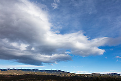 dramatic cloud formations over The Santa Fe Mountains in New Mexico
