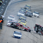 Joey Logano #20 bounces off the wall and crashes into Clint Bowyer #33 on the final lap of NASCAR Nationwide Series at Dover International Speedway in Dover Delaware.