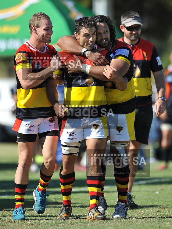 CAPE TOWN, SOUTH AFRICA - Saturday 28 February 2015, Monty Dumond of Hamiltons RFC is hugged by his captain, Jody Burch, during the second round match of the Cell C Community Cup between Hamiltons and Vaseline Wanderers at the Stephan Oval, Green Point.<br /> Photo by Roger Sedres/ImageSA/SARU