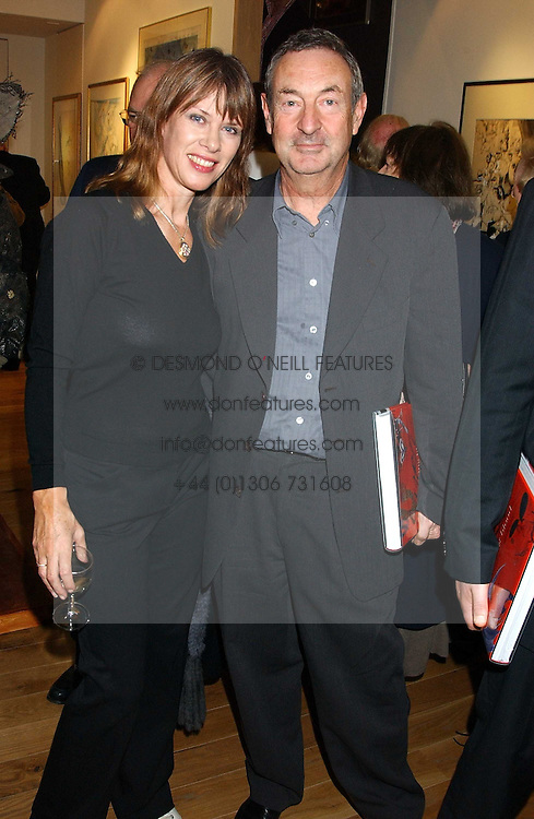 NICK &amp; NETTE MASON at a party to celebrate the publication of Drawing Blood -Forty-Five Years of Scarfe Uncensored, a book of Gerald Scarfe's work held at The Fine Arts Society, New Bond Street, London on 3rd November 2005.<br />
