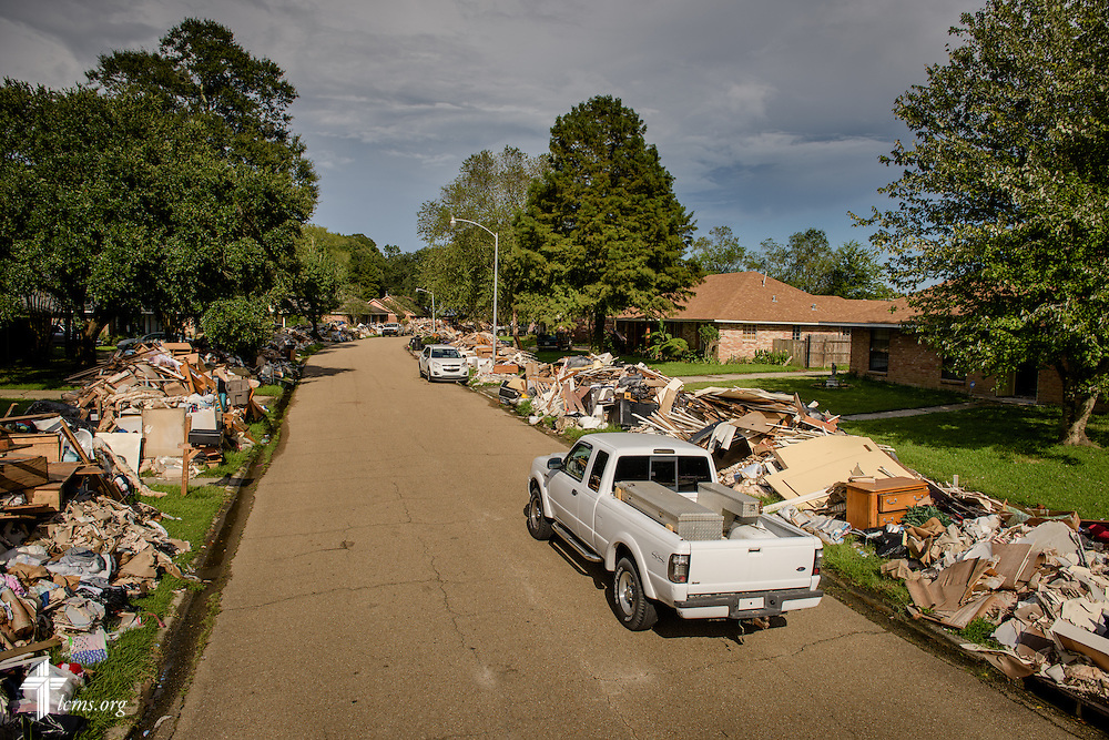 Debris from homes damaged in August flooding lines the street of a neighborhood on Tuesday, Sept. 13, 2016, in Baton Rouge, La.  LCMS Communications/Erik M. Lunsford