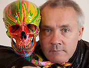 "Close-up Damien Hirst Portrait with his artwork.""St Elmo's Fire"".2008.Household gloss on plastic skeleton.1700 x 425 x 435 mm.© Damien Hirst. All rights reserved, DACS 2010.Photographed in his Chalford Studio, near Stroud, Gloucestershire"